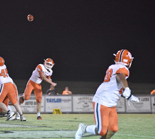 Bulldog quarterback Kolton Crochet throws across the backfield to Elijah Young.