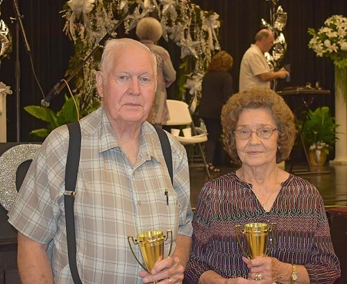 First Place Rook Winners: Norman Hillard and Christine McDonald. Not pictured are Second Place Rook Winners Ann Cook and Bobby Mann along with High Five First Place winners Herschel Byars and Paul Boyd, High Five Second Place Winners John Mann and Mildred Byars.