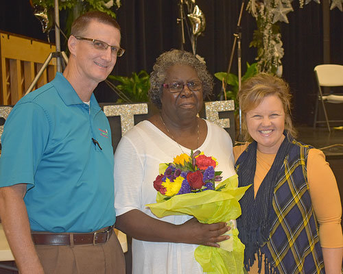 Tim and Natalie Jordan honor Wilma Pearson with the annual Hometown Hero Award.