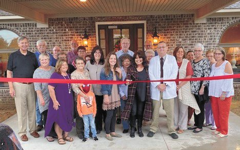 Cutting the Ribbon for the Grand Opening — Front (L to R): Mayor Howell Todd, Alderman Judy Grant Smith, Sherry Cannon Berry, Diane Cannon, Bentley Cannon, Office Manager Kim Bennett, Medical Assistant Leah Hamilton, Debra Cannon, Dr. John Blankenship, County Trustee Paula Bolen, Donna Jackson and Lisa Collins. Back (L to R): Bub Cantrell, Cary Don Smith, Debra Cantrell, Dwight Reed, Jean Hammond, Billy Murphy, June Murphy, Larry Wood, Terry Warren and Natelle Waugh.