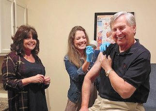 Mayor getting first shot (L to R) Debra Cannon, Leah Hamilton and Mayor Howell Wayne Todd