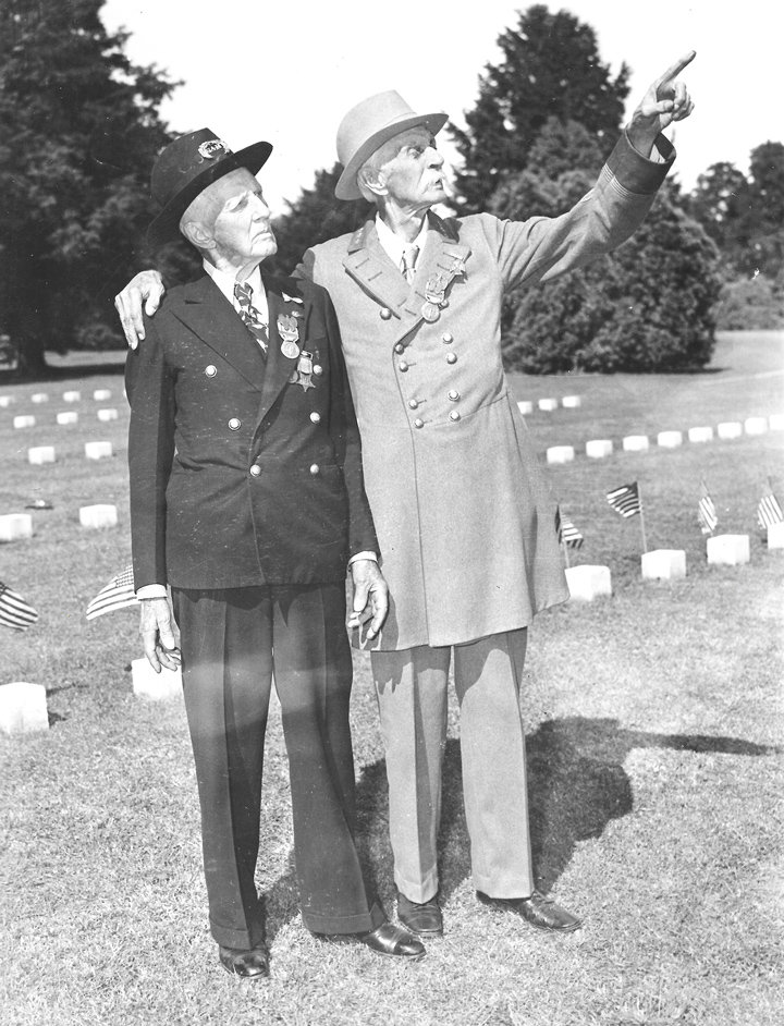 Martin A. Loop (left) 96-year-old Union veteran from Sacrament, Cal. and General John Williamson Harris, 90-year-old Confederate veteran in the National Cemetery at Gettysburg, which they visited to pay their respects to their fallen comrades. The photo was taken June 29, 1938.