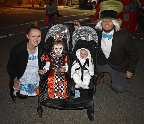 "The Maddoxes toured the square as characters from ""Alice in Wonderland."" Pictured are (L to R): Cayce, Cameron, Nora and Braden."