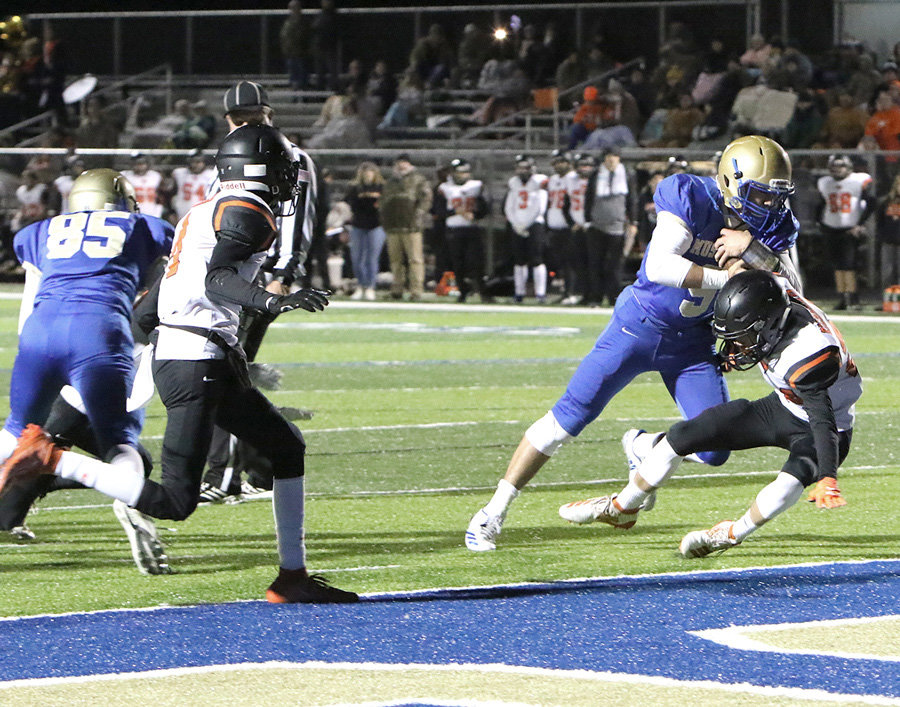 Mr. Football finalist Hunter Ensley bowls over a Richland Raider defender for one of his five touchdowns on the night.
