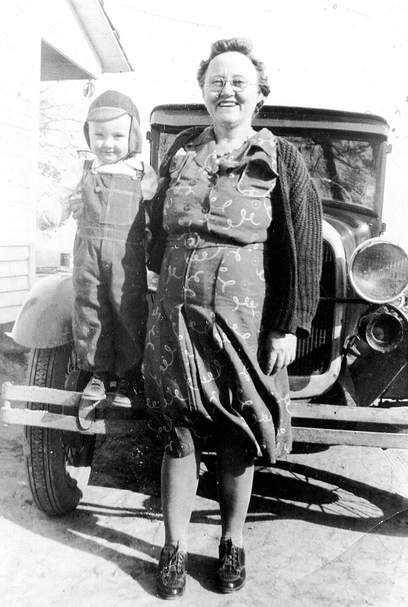 Susie Purvis and son, Jimmy Lee, pictured in front of the family 1928 Ford Model A Coupe with rumble seat, about 1942.