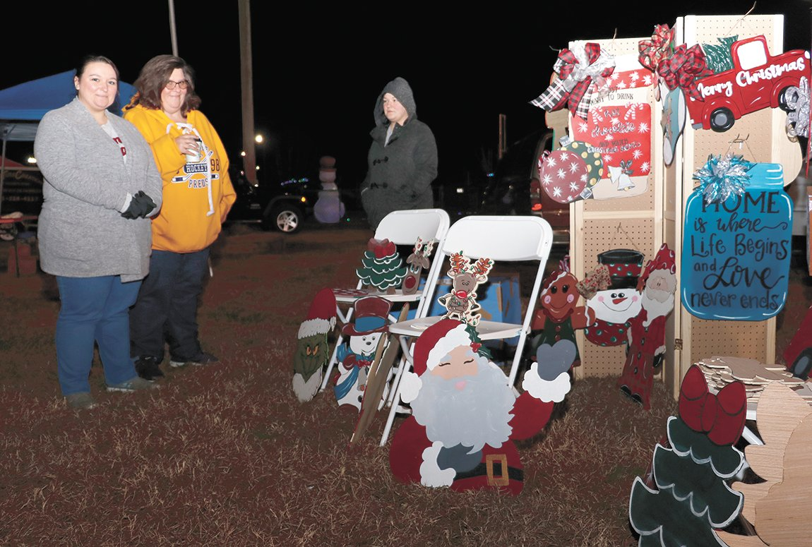 Katherina Roberts and Stacey Bendy display their handiwork of Christmas decorations at Gleason.