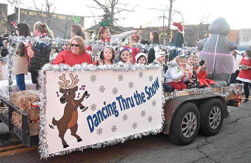 "Genia's School of Dance's float ""Dancing Thru the Snow"" was awarded first place."