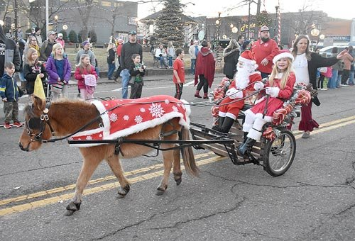 Santa and Mrs. Claus (Hunter Seiber and Anna Summers) riding in their sleigh were awarded Most Original (tie) in McKenzie's Christmas parade.