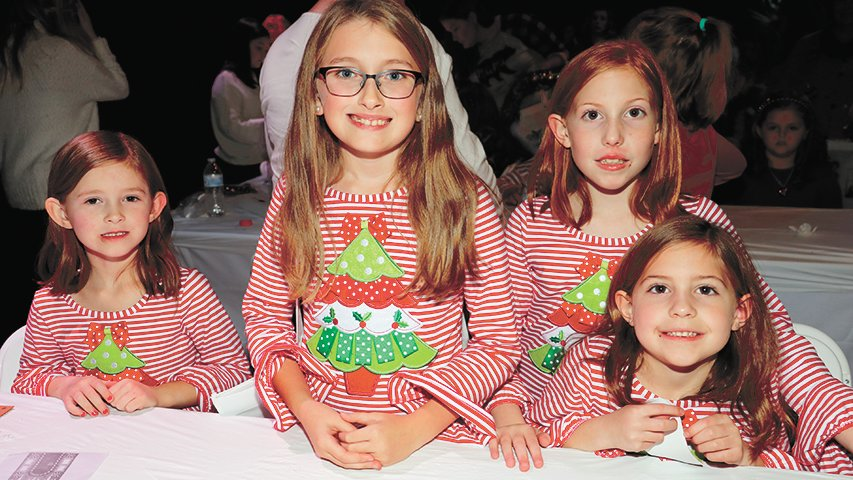 Hazel Roberson, Anna Claire Hardin, and Allison and Elizabeth Droke of Medina dressed alike for the event.