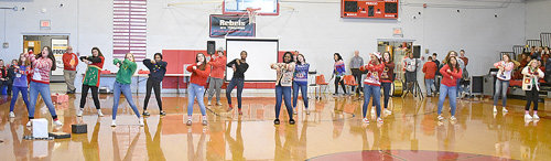 "Eighth graders perform a dance to ""All I Want for Christmas"" and other songs."