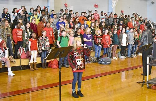 "Veda Haney's fifth grade music class performs ""Silent Night"" with Madelyn Pewitt as soloist."