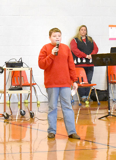 "Seventh grader Nathan Lease sings ""O Come All Ye Faithful."""