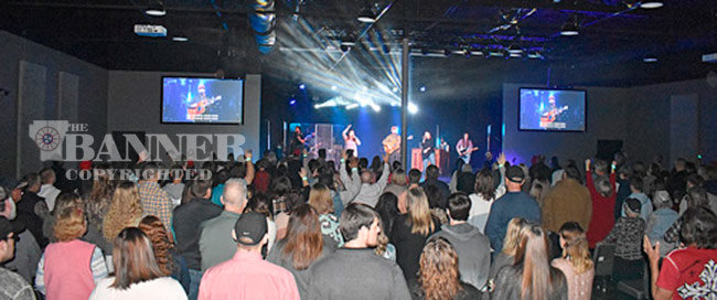 A standing-room-only crowd packs the new Overflow Church sanctuary for the second of two services on the first day in the new building.