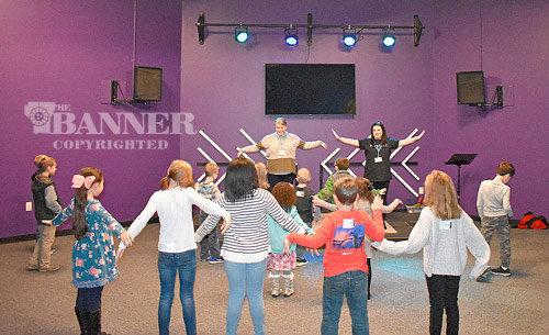 Aubrey Doyle (left) and Lauren Powers lead a fun youth service in the kids' worship area.