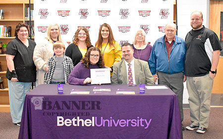 Above, Senior Marching War Eagle Alexis Houston signs with the Bethel University Renaissance Regiment. She is seated with Keith Cottrill, Bethel University Director of Bands. Standing are (L to R): West Carroll guard instructor Debbie Moncrief; Alexis's cousin, Amanda Houston; her brother, Alex Caviness; sister, Autumn Houston; mother, Stephanie Vinson; grandmother, Janice Vinson; grandfather, Vernal houston; and West Carroll Director of Bands Michael Nelson.