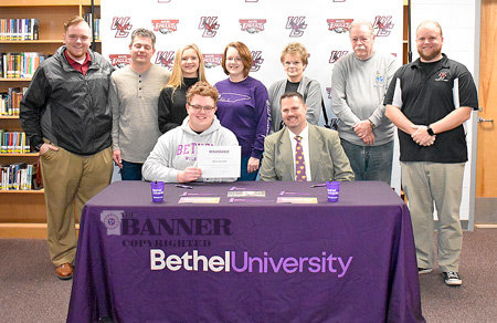 Senior Marching War Eagle Alex Arnold signs with the Bethel University Renaissance Regiment. He is seated with Keith Cottrill, Bethel University Director of Bands. Standing are (L to R): West Carroll Director of Percussion Adam Douglas; Alex's father, Mark Arnold; his sister, Olivia Arnold; mother, Sally Arnold; grandmother, Emily Garmany; grandfather, Mitch Garmany; and West Carroll Director of Bands Michael Nelson.