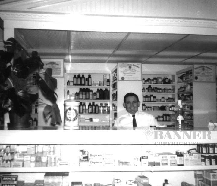 JT Lindsey behind the counter of the pharmacy in May 1965.