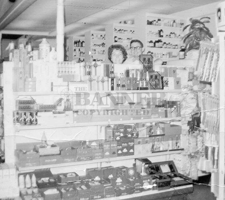 JT and Robye Lindsey behind the counter at Lindsey's Rexall Drugs, 1968.