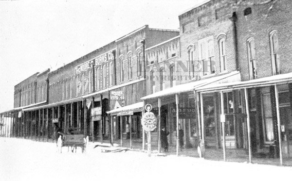 Western side of the public square, Downtown McKenzie with The Moore and Burns Co. center, the early 1900s.