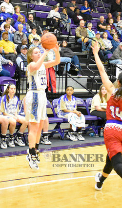 Huntingdon's Brooke Butler drains one of her two three-pointers.