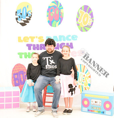 Troy Poff stops for a photo with granddaughter Payson Rodriguez (left), eight, and daughter Kinsley Poff, nine.