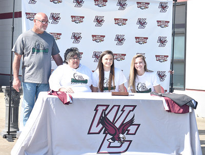 Lady War Eagle Macey Cunningham signs to join Clarendon College basketball. Pictured are (L to R): Macey's dad Frank Cochran, her mom Kim Cochran, Macey and her twin sister Gracie Cunningham.