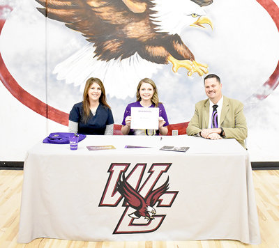 West Carroll senior Kaci Fowler signs with Bethel University Renaissance, joined by her mother Trish Ulrich (left) and Director of Renaissance Bands Keith Cottrill.