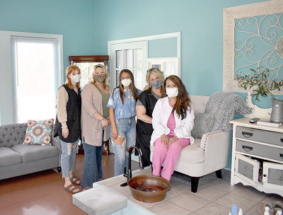 The staff at Rejuvenate MedSpa & Salon (L to R): Maggie Latimer, nail technician; Hollie Bell, stylist; Brittney Waddell, stylist; Reni Toombs, stylist; and Raquel Hixson, LPN, owner. Not pictured are Andrea Martin, stylist, and Brookelyn Ballard, nail technician.