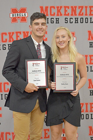 McKENZIE (May 15) — During Friday's Awards Day at McKenzie High School, senior basketball players Shelby Davis (right) and Lane Horton were awarded the inaugural Barbara Boyd Rebel Basketball Memorial Scholarship. The award is named for the late Barbara Boyd, a former McKenzie basketball player and teacher who died in January 2019. Davis is Boyd's granddaughter.