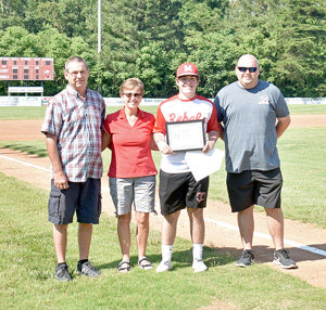 Rebel senior Cameron Kee was presented the Seth Foster Memorial Scholarship. Pictured are (L to R): Seth's parents Mike and Rachel Foster, Kee and Seth's brother Matt.