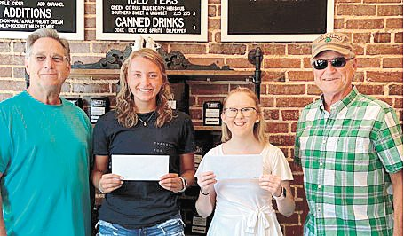 Huntingdon High School Alumni Association presented two scholarships to 2020 graduates of the school. Pictured (L to R) Carl Byars, Alumni treasurer, recipients Adyn Swenson and Hannah Reeves, and Barry Murphy, alumni board member. Recipients received $1,000 scholarship.