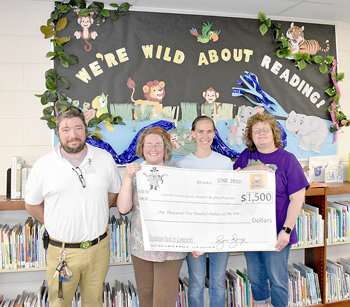 Cox Oil made a $1,500 donation to the Carroll County Library's Summer Reading program. Pictured are (L to R): Michael Crowley, Huntingdon Little General store manager; Jennifer Thornton, Carroll County Library director; Grace Hawkins, children's librarian; and Denise Coleman, CCL assistant director.