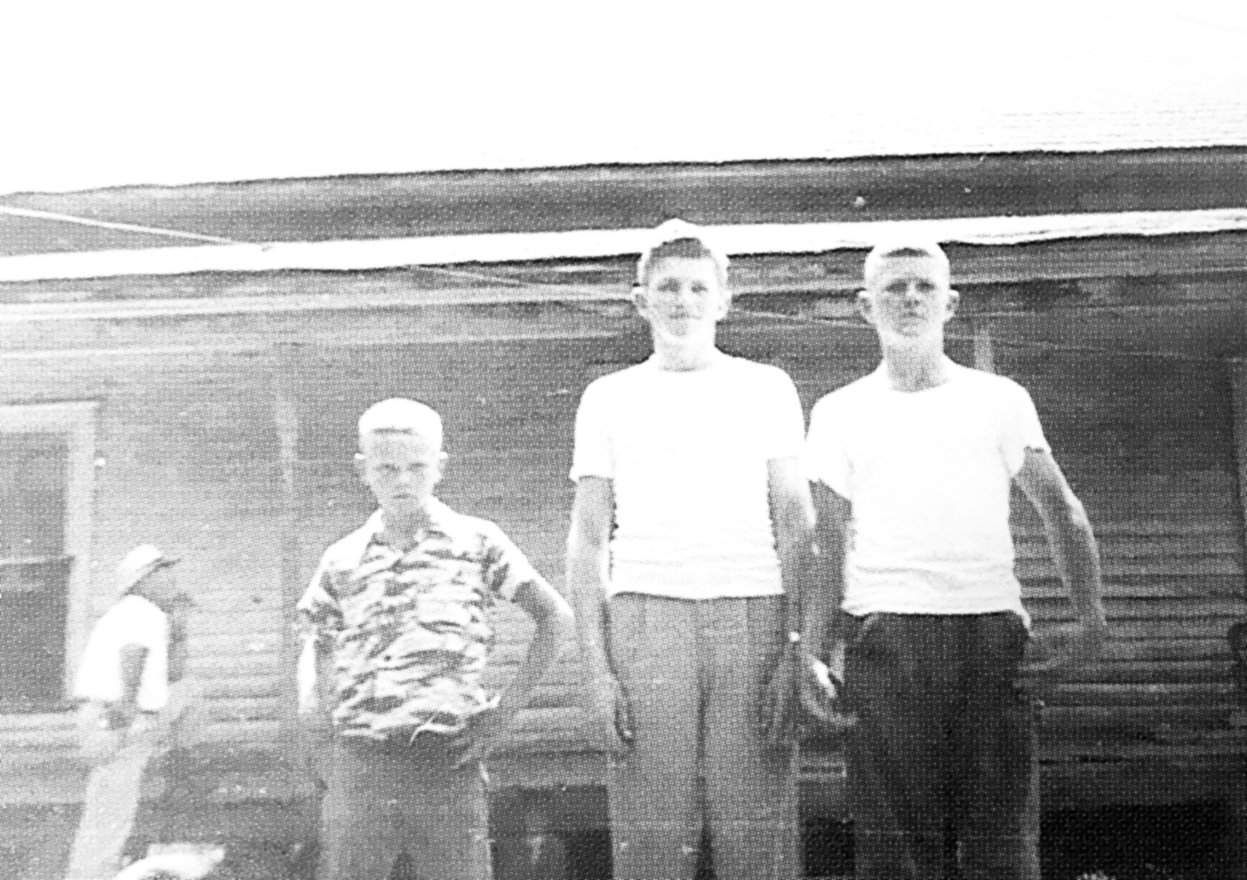 "The Morris brothers in 1952 at ""The Old Place."" Pictured (L to R) Joe, Jack (who had enlisted in the Navy) and Ray."