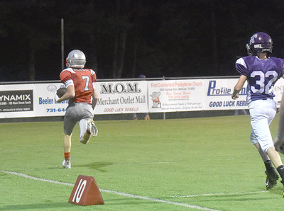 Rebel Landon Brown takes a catch 48 yards for a game-tying touchdown late in the first quarter.
