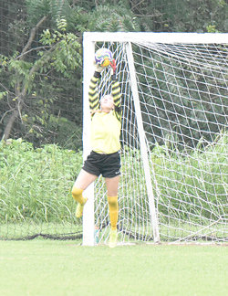 Lady Rebel goalkeeper Gracie Dillingham stretches for one of her four saves in Thursday's shutout of Crockett County.