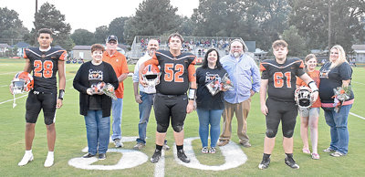 Gleason High School Football seniors (L to R): Elijah Young with parents Becky and Roger Sawyers; Cayden Hughes with parents Lanny Hughes and Brittany and Steven Mitchell; and Lance Montgomery with sister Chesney Vaughn and mother A.J. Vaughn.