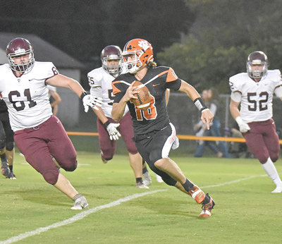 Bulldog quarterback Kolton Crochet scrambles for an eight-yard gain, setting up a touchdown two plays later.