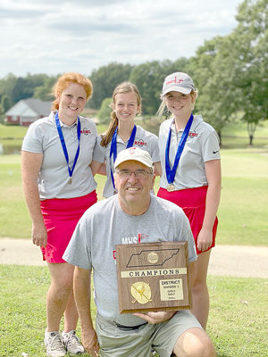 Pictured are (L to R): Coach Larry Joe Smith (kneeling), Payton Ognibene, Juleyanne Weatherford and Maggie Glass.