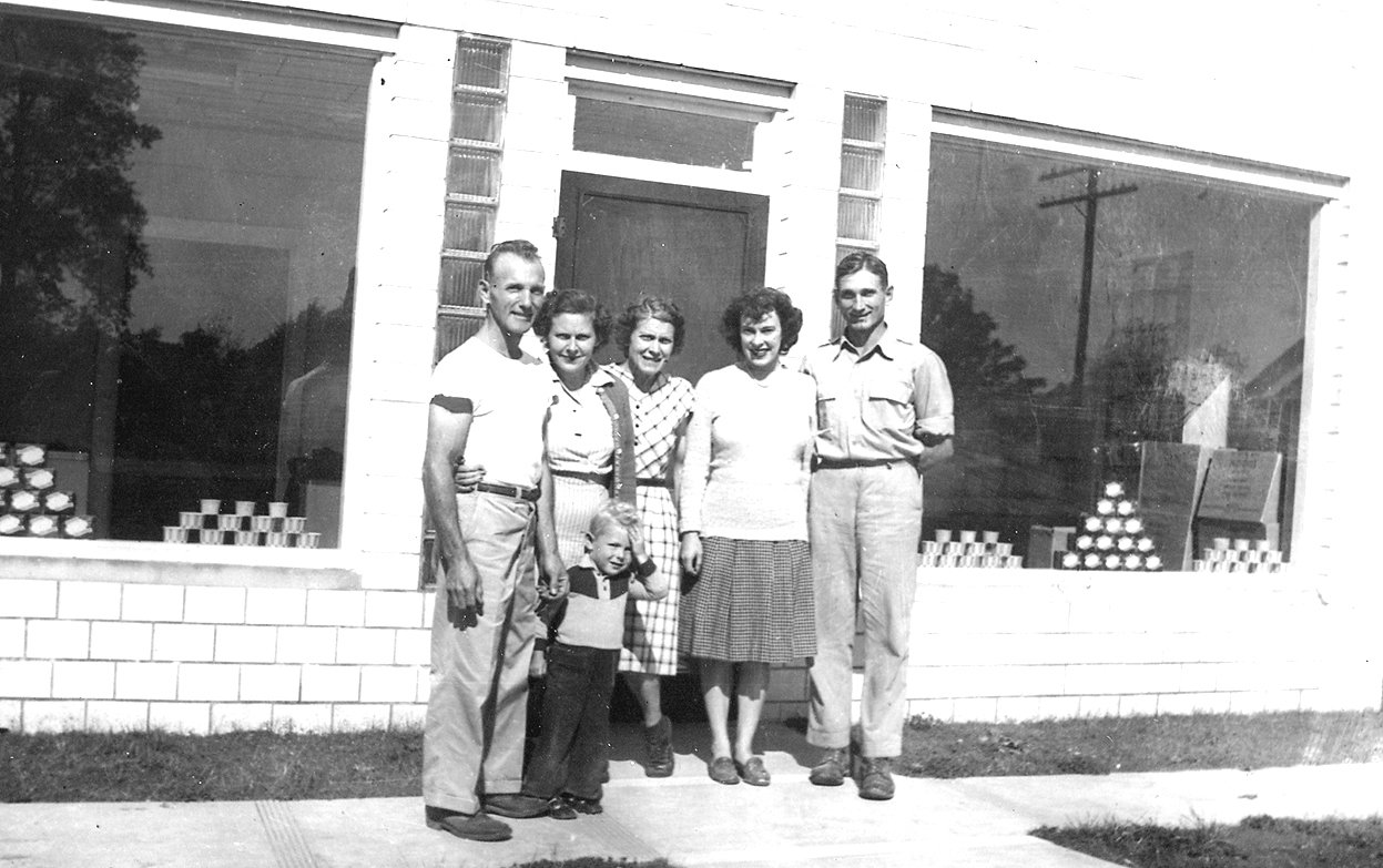 Holland Farms Ice Cream Company, 1947: Pictured: owners Paul G. Holland, Alma Holland, Mary Holland and Kermit Holland. Also pictured: Paul W. Holland, age 3, and Anne H. Waggoner.