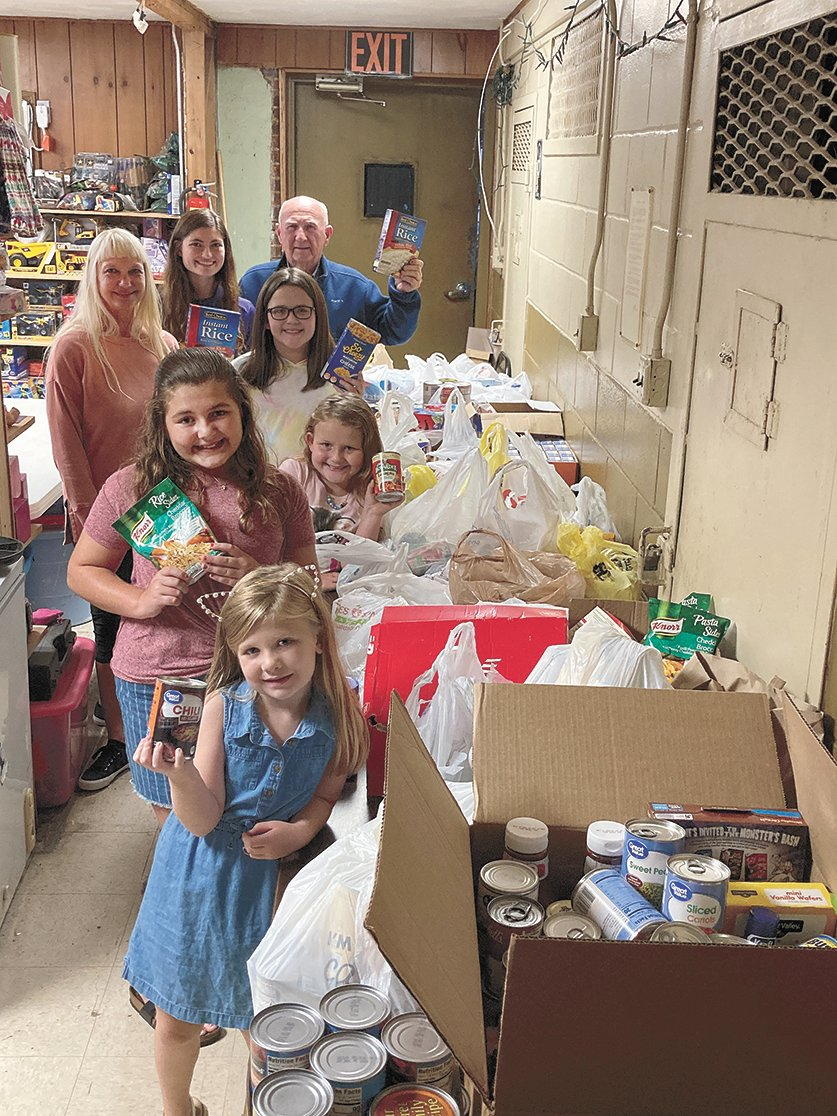 Donation of Food to United Neighbors — Attendees were: (Front to back) Kinslee Robertson, Brylee Robertson, Emily Ferguson, Annie Ferguson, Saudia Akin, LeAnn Webb, and Larry Robertson