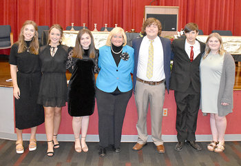MHS Beta Club officers with guest speaker Chancellor Vicki Hoover (L to R): Secretary Lauren Mansfield, Treasurer Anna Grace Spivey, Vice President Lyndsey Summers, Chancellor Hoover, President Will Gallimore, Parliamentarian A.J. Murphy and Reporter Madison Minard.