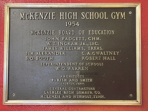 The 1954 placard in the lobby of the McKenzie Middle School designates the date of construction 67 years ago. The MMS gymnasium was constructed in 1954. It has the original vaulted roof. The flooring, lighting, and seating are among the items that have been replaced.