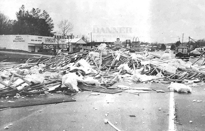 The splintered remains of Tommy's Carpet stretches across Highway 79 in McKenzie shortly after it was struck by a tornado.