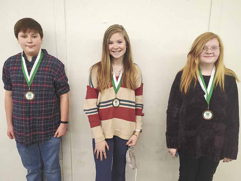 Sixth Grade (from left): 1st Place - Caitlin Langley (McKenzie), 2nd Place - Madelyn Morris (McKenzie) and 3rd Place - Wade Chandler (McKenzie).