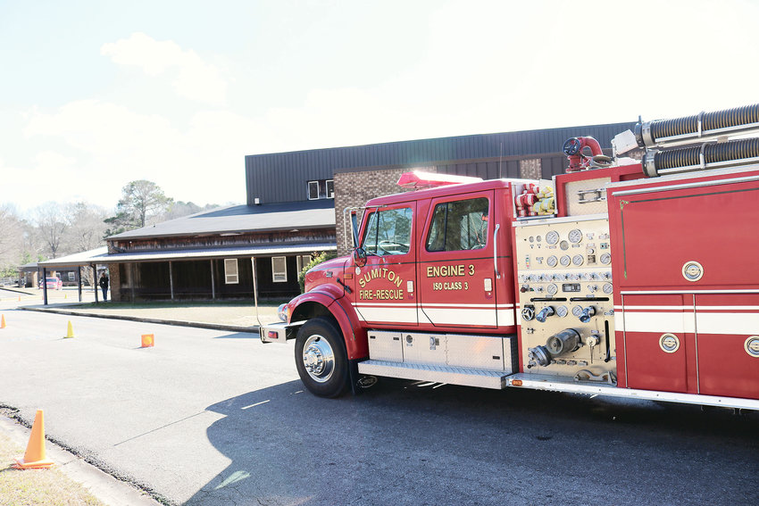 A Sumiton fire truck is station near Sumiton Middle School after a gas leak occurred at the school Monday.
