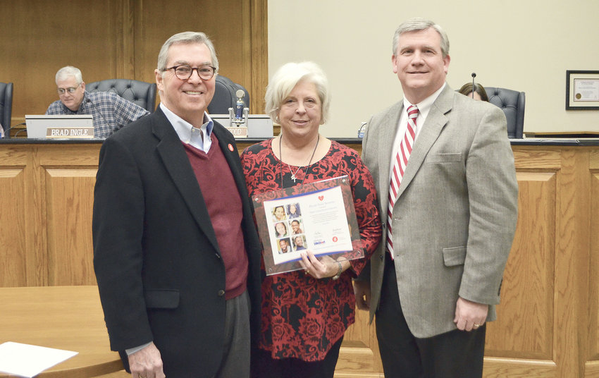 At left, Director of Alabama LifeStart Chris Brown presents a certificate to certify all schools in the Walker County district as Heart Safe to Walker County Schools Director of Health Services Margaret Guthrie and Walker County Schools Superintendent Dr. Joel Hagood.