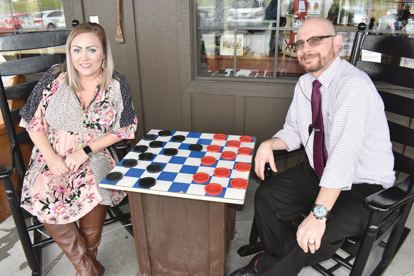Brittany Campbell, left, the new retail manager at Cracker Barrel in Jasper, and Mark Gajdosik, the store's general manager, share a moment in the famous rockers sold at the business. The retail store at the Jasper location was recently named the best in Fiscal 2018 across the entire national chain.