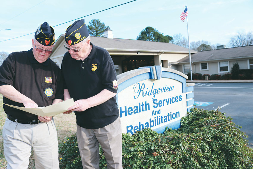 American Legion Chaplain Larry Stewart and Jack Smith look over the names of the veterans currently residing at the Ridgeview Healthcare and Rehabilitation facility. The two veterans handle visitations at local nursing and assisted living homes.
