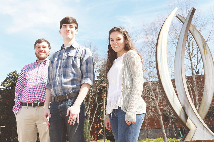 Brandon Carter, Ryan Williams, and Emma Latham are standing next to a sculpture by the UAB School of Engineering building. Williams was the 2019 recipient of the Undergraduate Student of the Year. Carter received the award in 2017 and Latham in 2018.