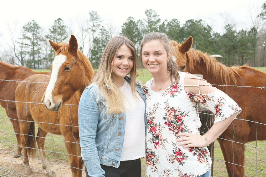 Exchange student Federica Riccardi of Triste, Italy, left, is spending her senior year at Dora High School. She rode horses for the first time with her host sister Haley Phillips of Empire.